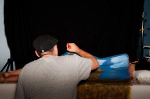 """Sean Selfridge painting """"Top Heavy"""" on model"""